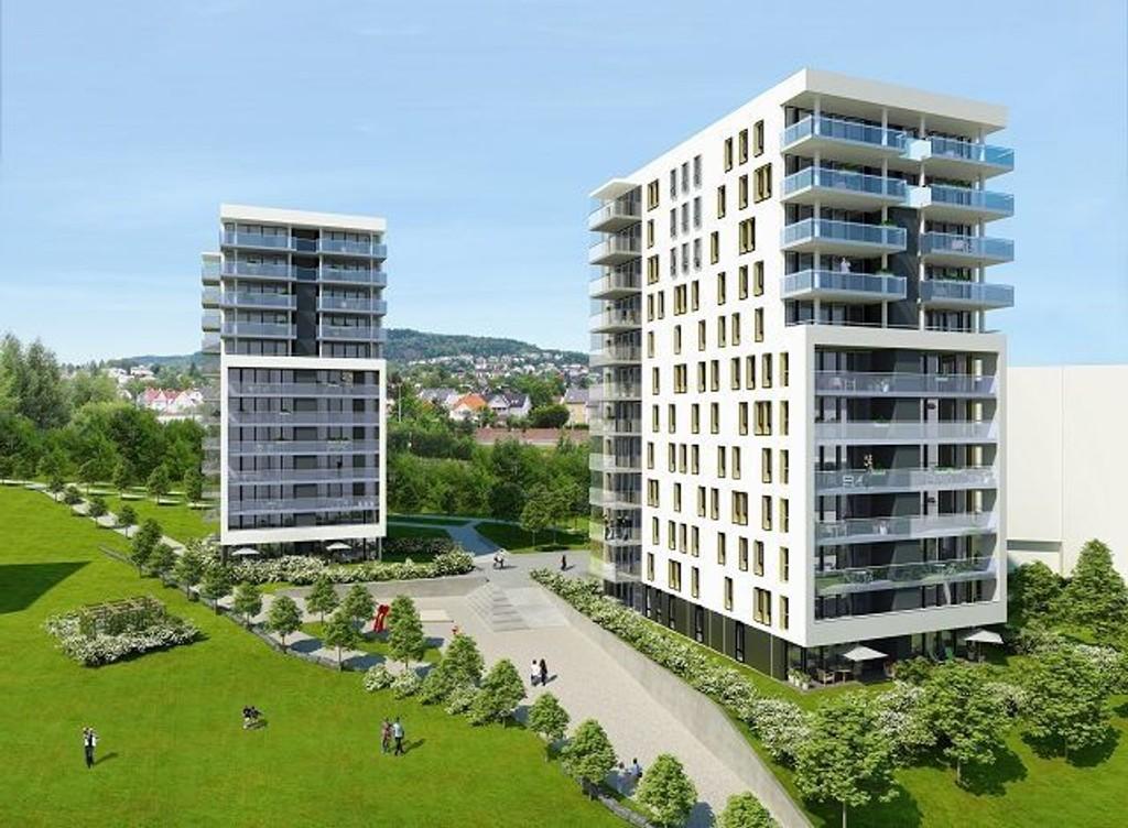 Første byggetrinn: «Monolittene», Hus 1 og 2, vil stå ferdig i 2012. Tidlig i neste år starter byggingen. Byggene blir omgitt av en grønn park med vannspeil. ILLUSTRASJON: JM AS/ROM EIENDOM