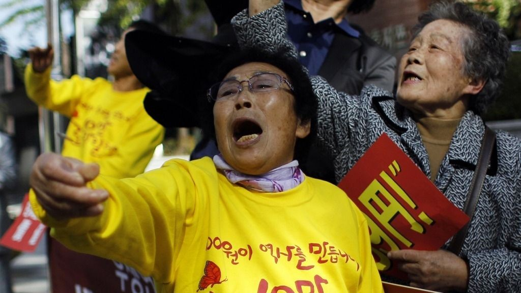 The 83-year-old Yang Keum-duk, who said was forced to work in Japan during the 1910-45 colonization of the Korean Peninsula, wipes her tear during a rally ahead of Japanese Prime Minister Yoshihiko Noda's visit in front of the Japanese Embassy in Seoul, South Korea, Tuesday, Oct. 18, 2011. South Korean civic group members said Japan has paid 99 yen (about US$1.30) as part of a welfare pension refund to some South Korean women who were forced to work.