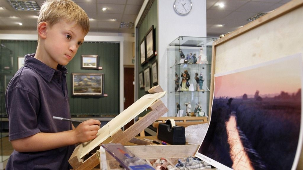 In this Thursday, Aug. 12, 2010 photo Kieron Williamson, an eight-year-old painting prodigy is seen working on a drawing in Holt, Norfolk in England. He's Britain's most talked-about young artist. His paintings sell for thousands of dollars and there's a long waiting list for his eagerly anticipated new works.