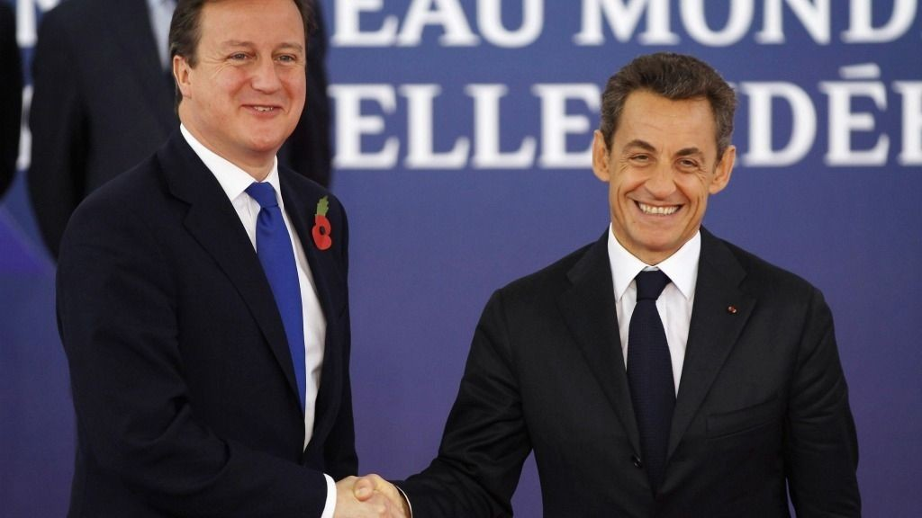 French President Nicolas Sarkozy welcomes British Prime Minister David Cameron to the G20 Summit in Cannes, France.
