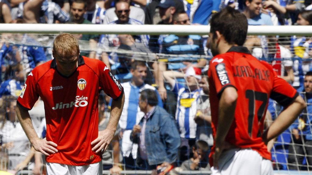 Valencia's Jeremy Mathieu (L) and Jordi Alba react after Espanyol score a goal during their Spanish First division soccer league match at Cornella-El Prat stadium, near Barcelona April 15, 2012.