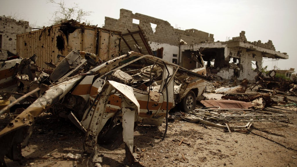 Vehicles and buildings destroyed during recent fighting between the army and al Qaeda-linked militants are seen on a road leading to the southern Yemeni city of Zinjibar June 14, 2012.