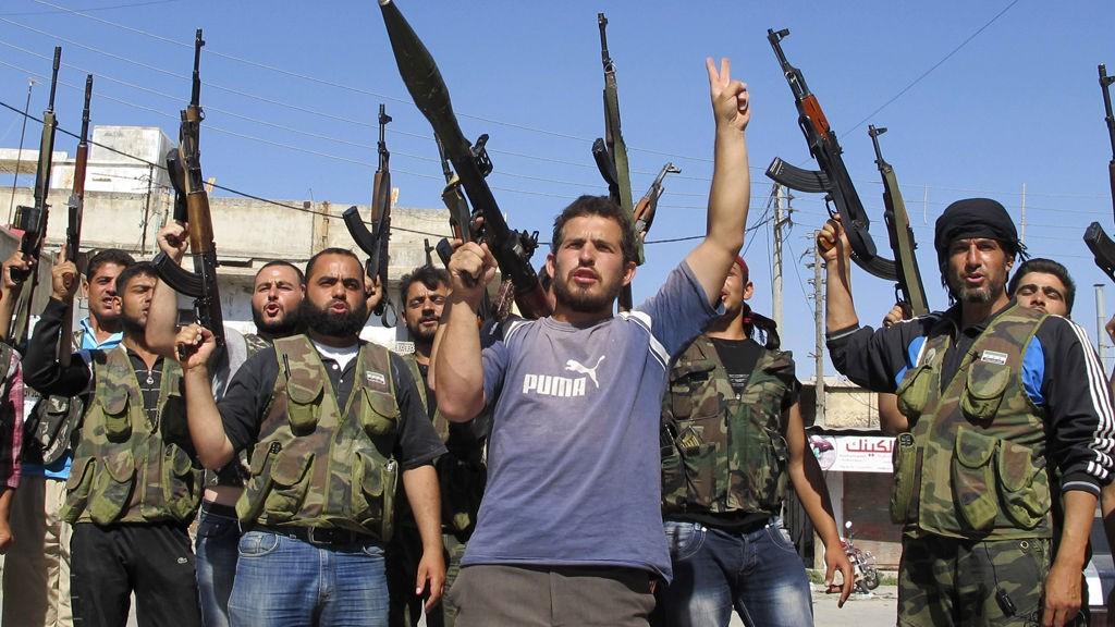 Members of the Free Syrian Army chant slogans against Syrian President Bashar al-Assad in Azzaz
