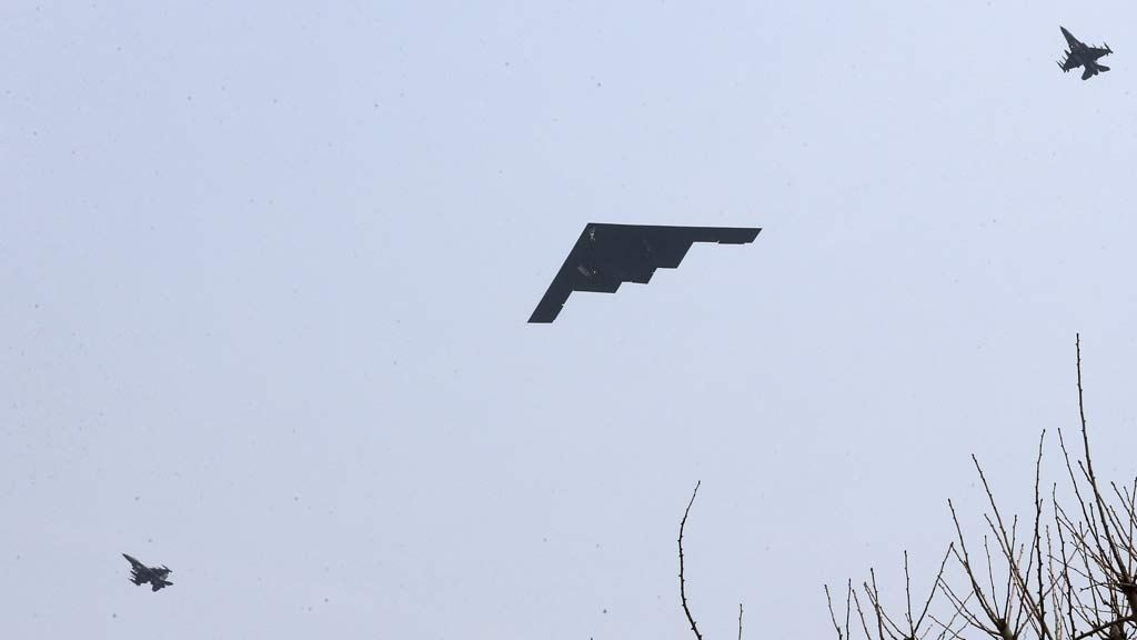 U.S. Air Force B-2 stealth bomber flies over near Osan U.S. Air Base in Pyeongtaek, south of Seoul, South Korea, Thursday, March 28, 2013. A day after shutting down a key military hotline, Pyongyang instead used indirect communications with Seoul to allow South Koreans to cross the heavily armed border and work at a factory complex that is the last major symbol of inter-Korean cooperation.