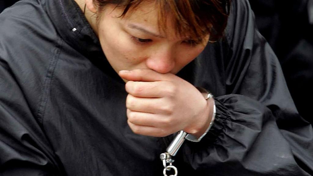 ARRESTERT KVINNE: Illustrasjonfotoet viser en kvinne som ble arrestert i Kina for et mindre alvorlig forhold.