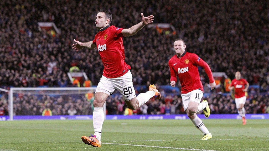 File photo dated 19/03/2014 of Manchester United's Robin van Persie (left) celebrating scoring their third goal, and his hat-trick.