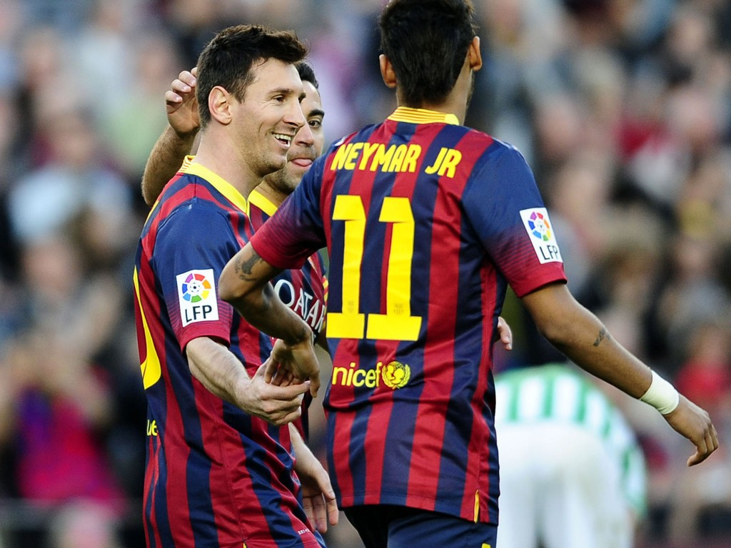 FC Barcelona's Lionel Messi, from Argentina, left, reacts after scoring with his teammate Neymar, right, during a Spanish La Liga soccer match against Betis at the Camp Nou stadium in Barcelona, Spain, Saturday, April 5, 2014. (AP Photo/Manu Fernandez)