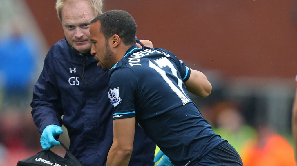 Tottenham Hotspur's Andros Townsend is helped to the touchline during the Barclays Premier League match at the Britannia Stadium, Stoke On Trent.