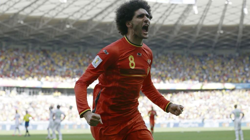 1-1: Marouane Fellaini jubler etter sin utligning mot Algerie.