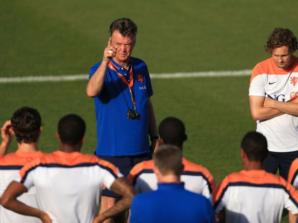 Netherlands' manager Louis van Gaal speaks to his players during a training session at the Estadio Jose Bastos Padilha, Rio de Janeiro, Brazil.