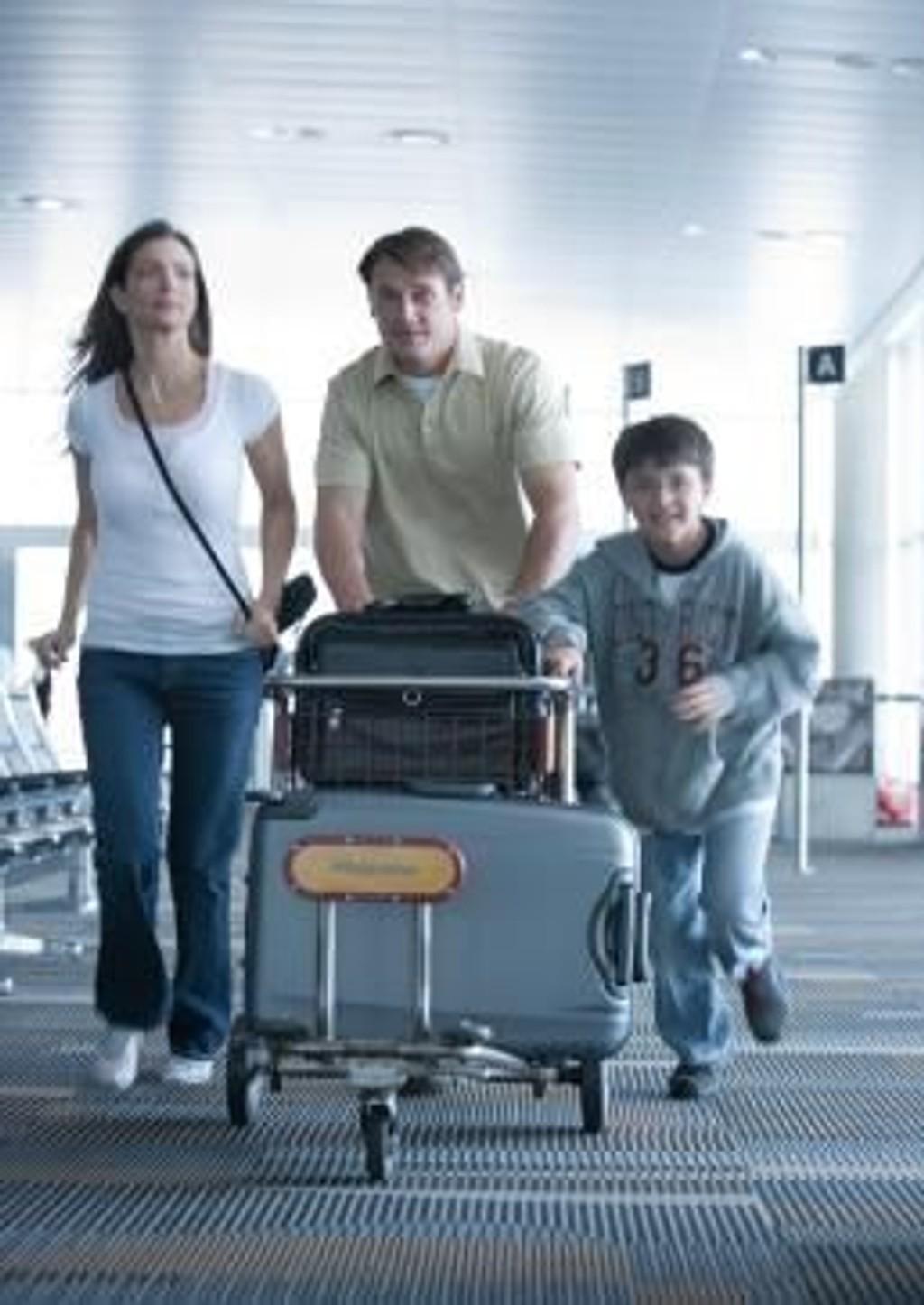 kvinnen med den tunge kofferten