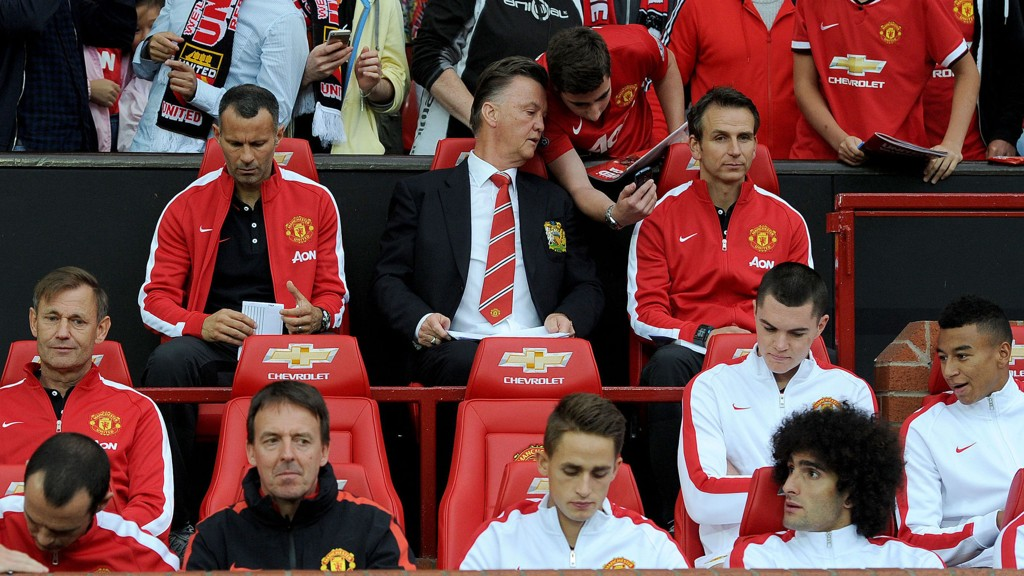 Manchester United manager Louis van Gaal takes his seat next to his assistant Ryan Giggs, during a pre season friendly at Old Trafford, Manchester.
