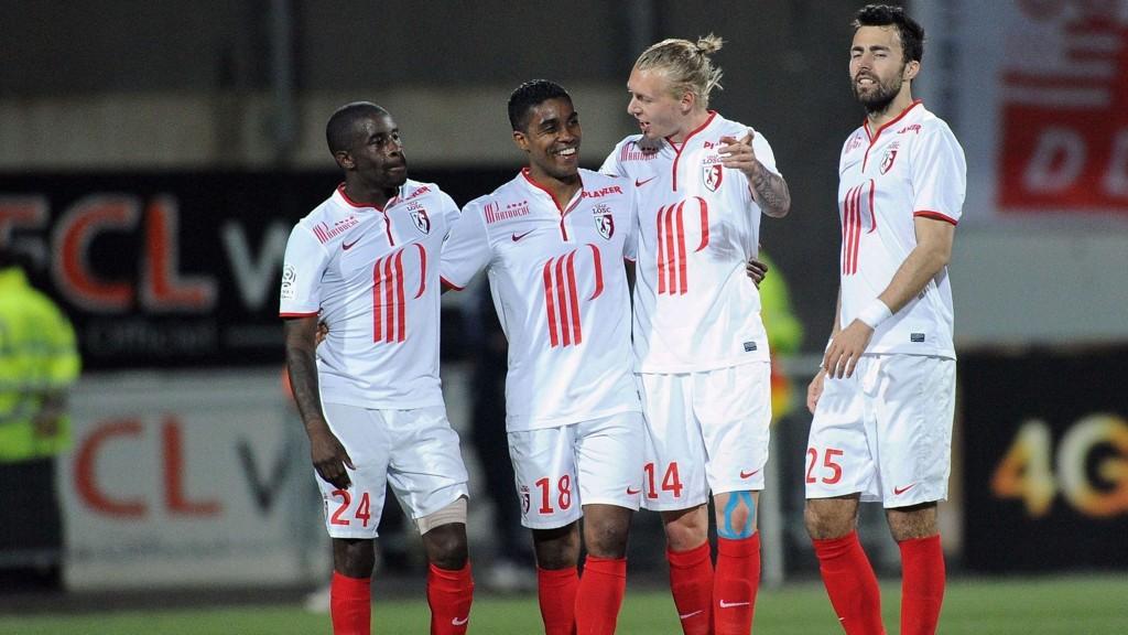 Simon Kjær og Marko Basa (spillerne til høyre) utgjør et av de beste stopperparene i Ligue 1. I kveld skal Lille-duoen demme opp for Portos angripere.