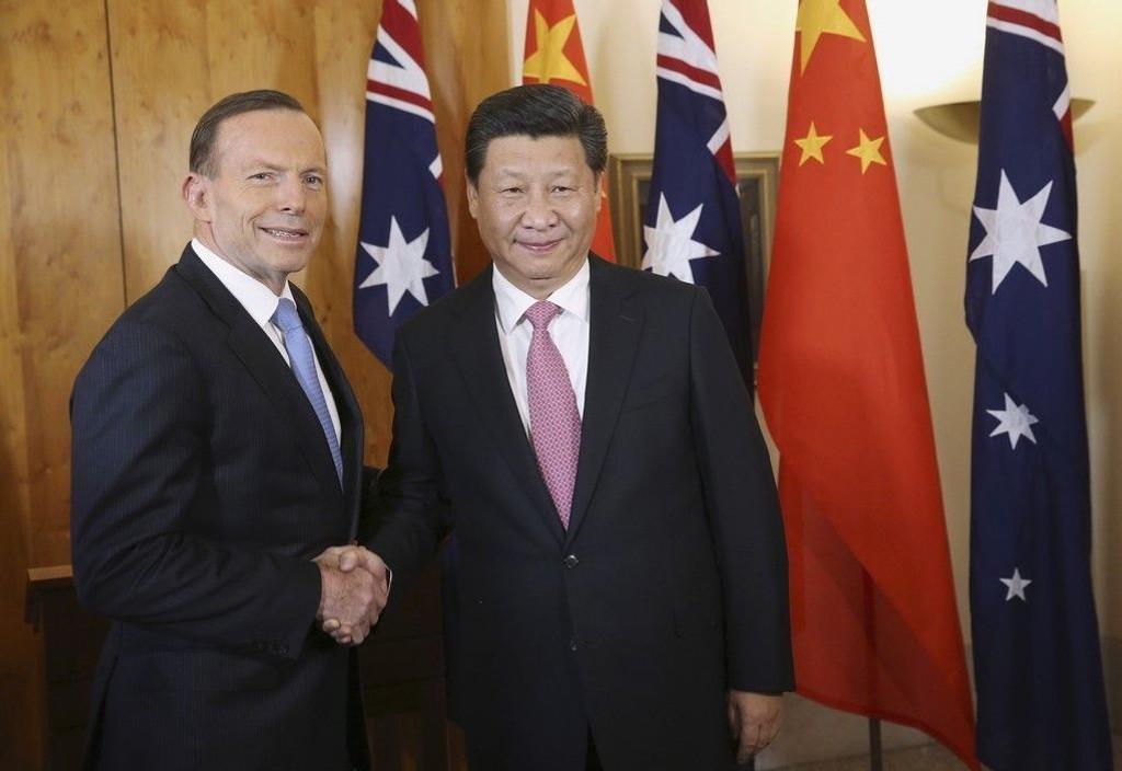 Kinas president Xi og Australia's statsminsiter Abbott i mål etter mange år med forhandlinger mellom de to landene.
