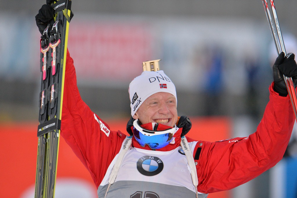 Norway's winner Johannes Thingnes Boe celebrates on his way to the podium after the men's 10 km sprint biathlon World Cup competition, in Hochfilzen, Austria, on Friday, Dec. 12, 2014. (AP Photo/Kerstin Joensson)
