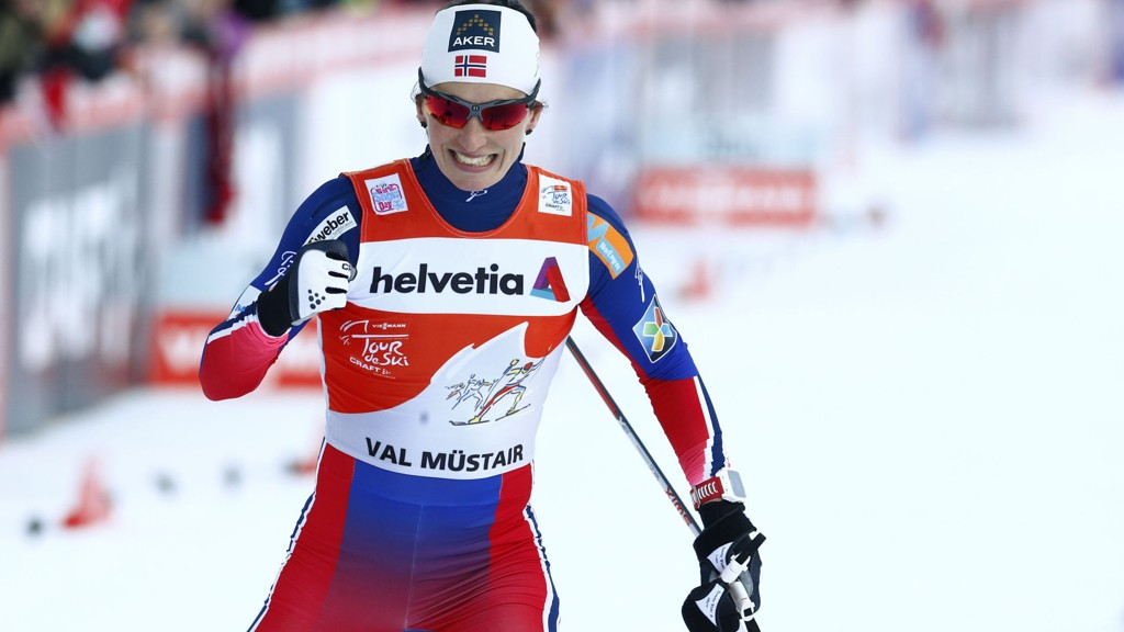 VAL MÜSTAIR, SVEITS 20150106. Marit Bjørgen jubler etter å ha vunnet sprinten i den 3. etappen i Tour de Ski i Val Müstair i Sveits tirsdag. Foto: Heiko Junge / NTB scanpix