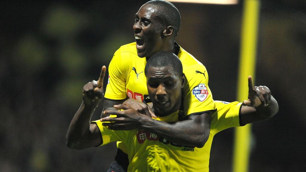 Odion Ighalo (nederst) feirer scoring sammen med lagkamerat Lloyd Dyer.