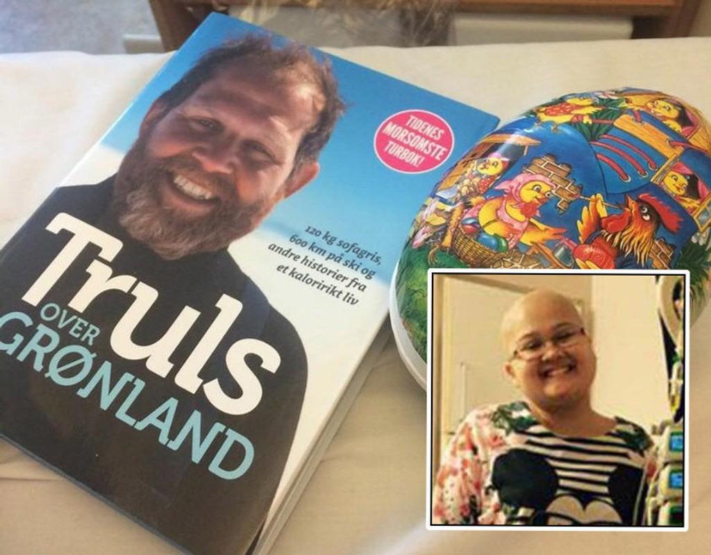 I SMAK: Innholdet i begge gavene fra Truls Svendsen falt absolutt i smak for unge Sarah Skruverud. Godteriet er det lite igjen av, og boken har hun allerede begynt på.