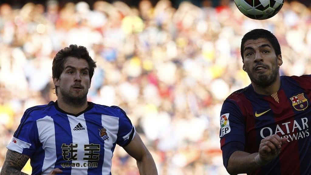 KOBLES TIL LIVERPOOL: Inigo Martinez (til venstre) skal være aktuell for den forrige klubben til mannen til høyre, Luis Suarez. Altså Liverpool.