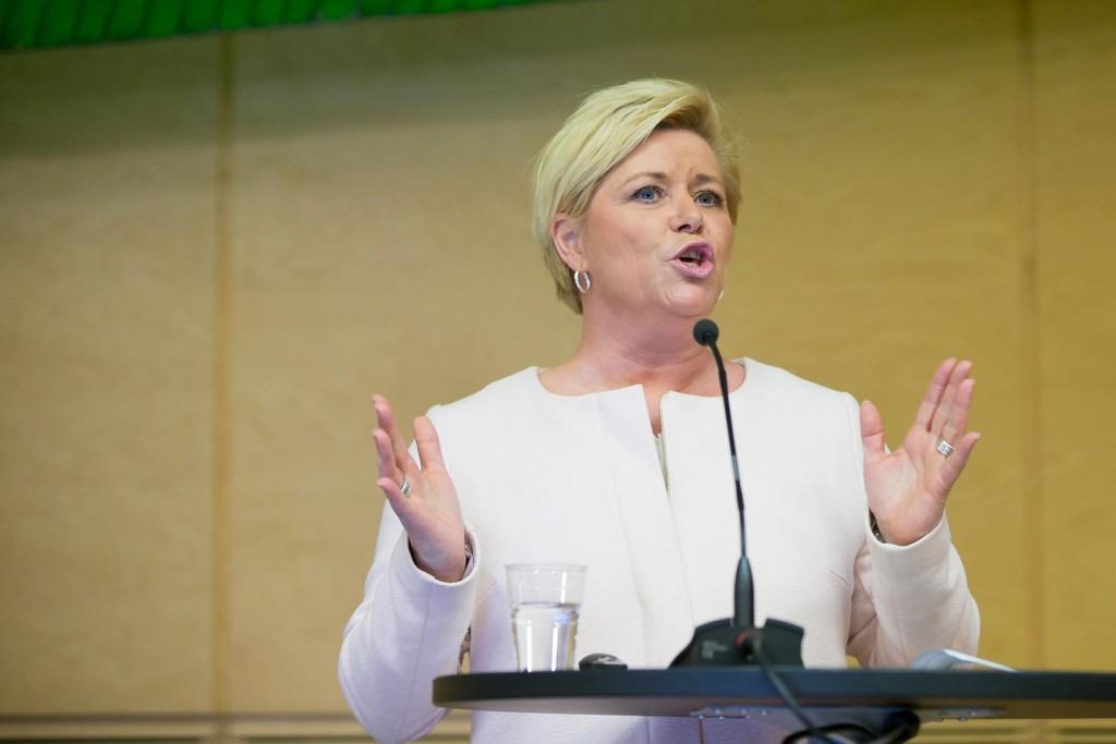 Finansminister Siv Jensen (Frp) avviste kritikken fra de rødgrønne opposisjonspartiene under debatten om revidert nasjonalbudsjett fredag.