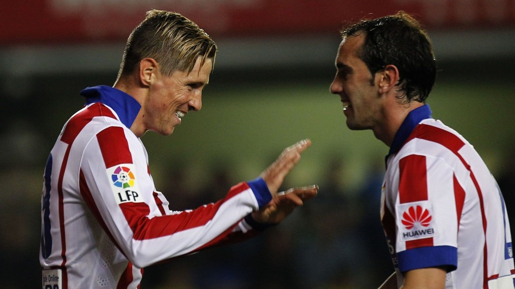 Fernando Torres (t.v) og Diego Godin. FOTO: NTB scanpix
