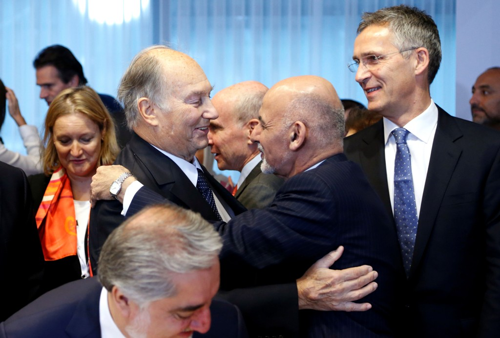 (L-R) Agha Khan, spiritual leader of Shia Ismaili Muslim community, greets Afghanistan's President Ashraf Ghani next to NATO Secretary-General Jens Stoltenberg during the Brussels Conference on Afghanistan, in Belgium, October 5, 2016. REUTERS/Francois Lenoir