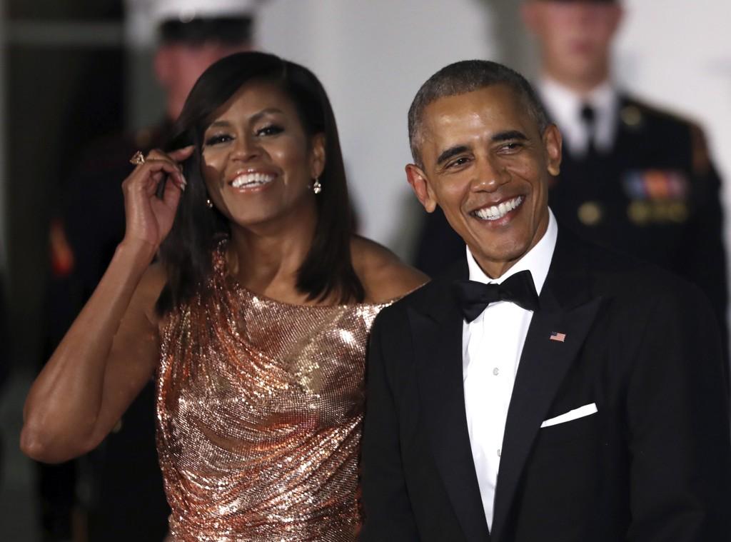 POPULÆRE: I en meningsmåling sier 64 prosent av de spurte at de liker USAs førstedame Michelle Obama, mens 54 prosent sier de liker president Barack Obama. Nå vil internett ha Michelle Obama som president. Foto: Scanpix