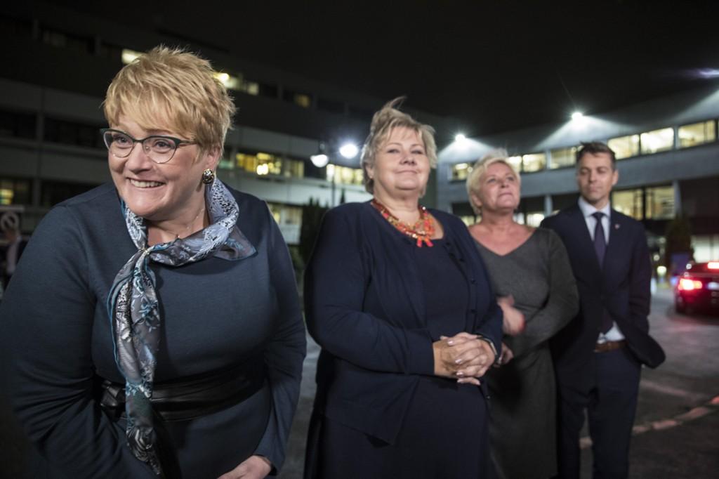 Venstre-leder Trine Skei Grande, statsminister Erna Solberg, Frp-leder Siv Jensen og KrF-leder Knut Arild Hareide på vei inn til partilederdebatt i NRK.