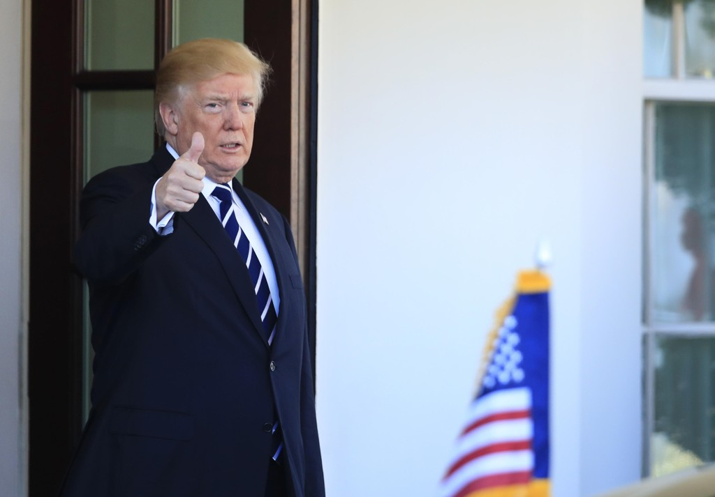 Donald Trump President Donald Trump flashes a thumbs up as the vehicle carrying visiting Libyan Prime Minister Fayez al-Sarraj, arrives outside the West Wing at the White House in Washington, Friday, Dec. 1, 2017. (AP Photo/Manuel Balce Ceneta)
