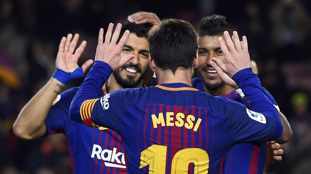 Lionel Messi og Luis Suarez har vært ustoppelige for Barcelona denne sesongen. Her flankert av Paulinho.