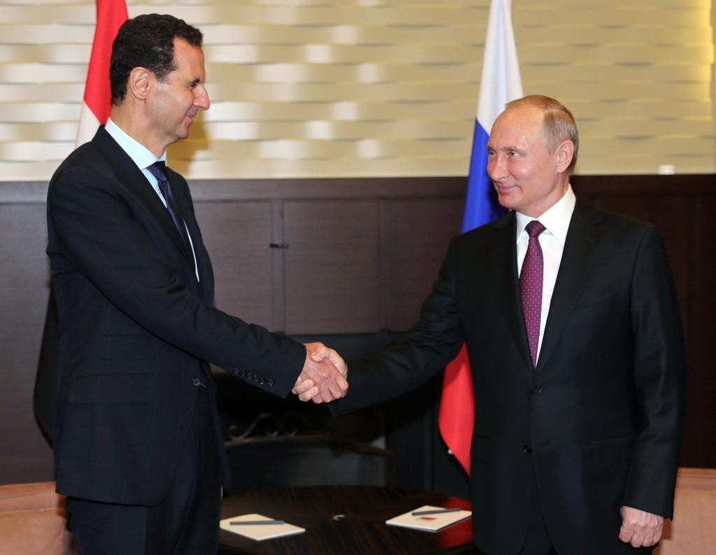 Russlands president Vladimir Putin tok imot Syrias president Bashar Al-assad i Sotsji torsdag. Foto: AP / NTB scanpix.