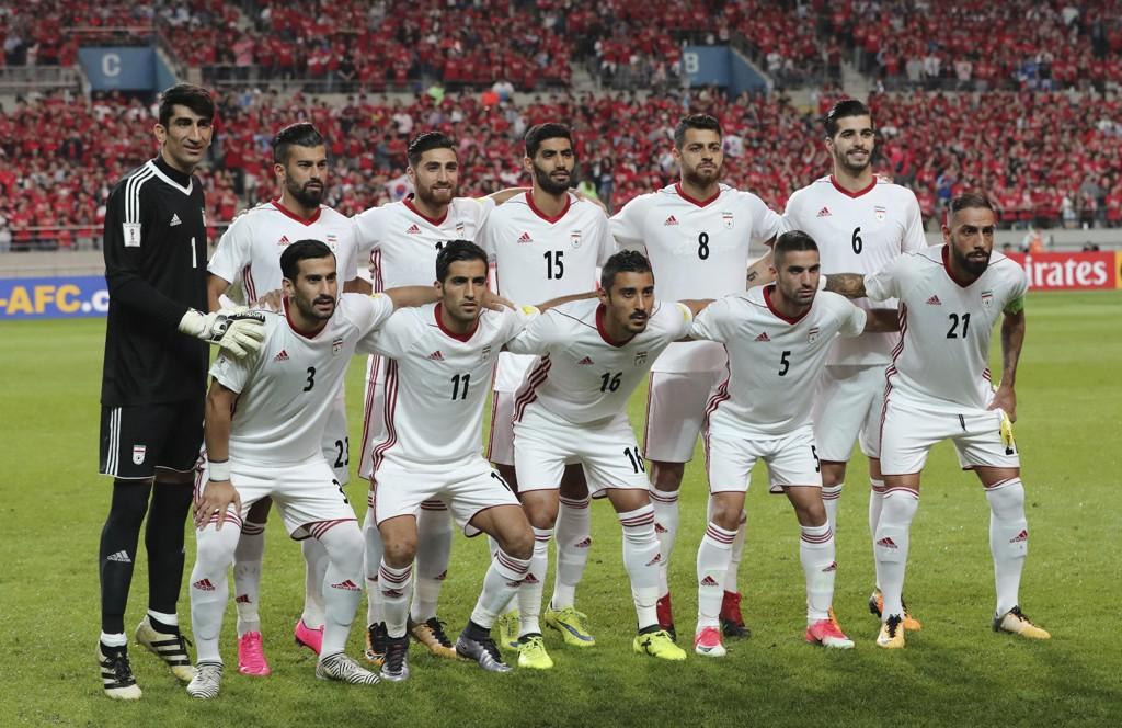 Det iranske VM-laget får ikke sko av Nike til VM. Foto: AP Photo/Lee Jin-man / NTB scanpix.