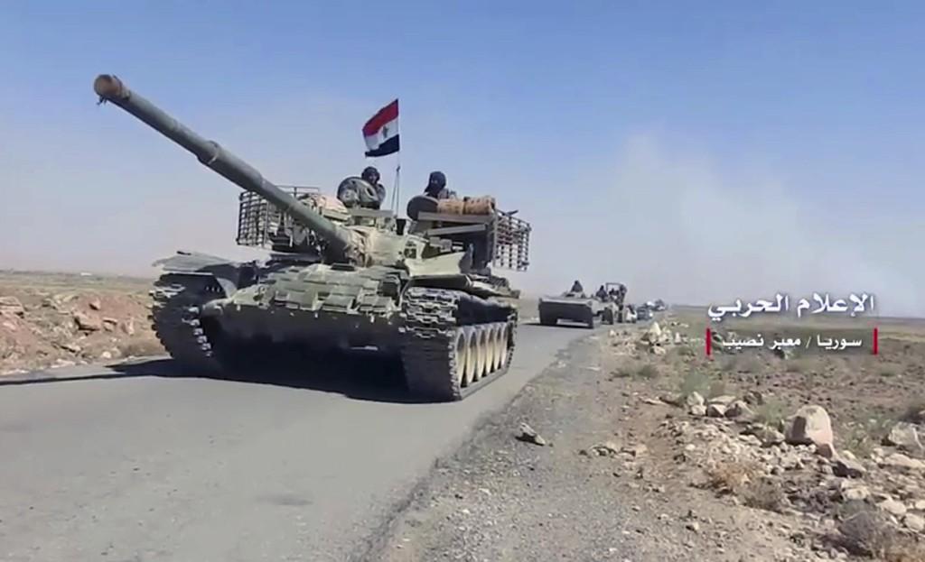 Bildet viser regjeringsstyrker i Daraa-provinsen tidligere i juli. Bildet er fra statlige medier. Foto: AP / NTB scanpix