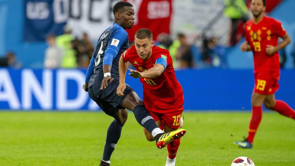 Eden Hazard i aksjon for Belgia i sommerens semifinale mot Frankrike. Her ser vi Hazard i duell med Paul Pogba.