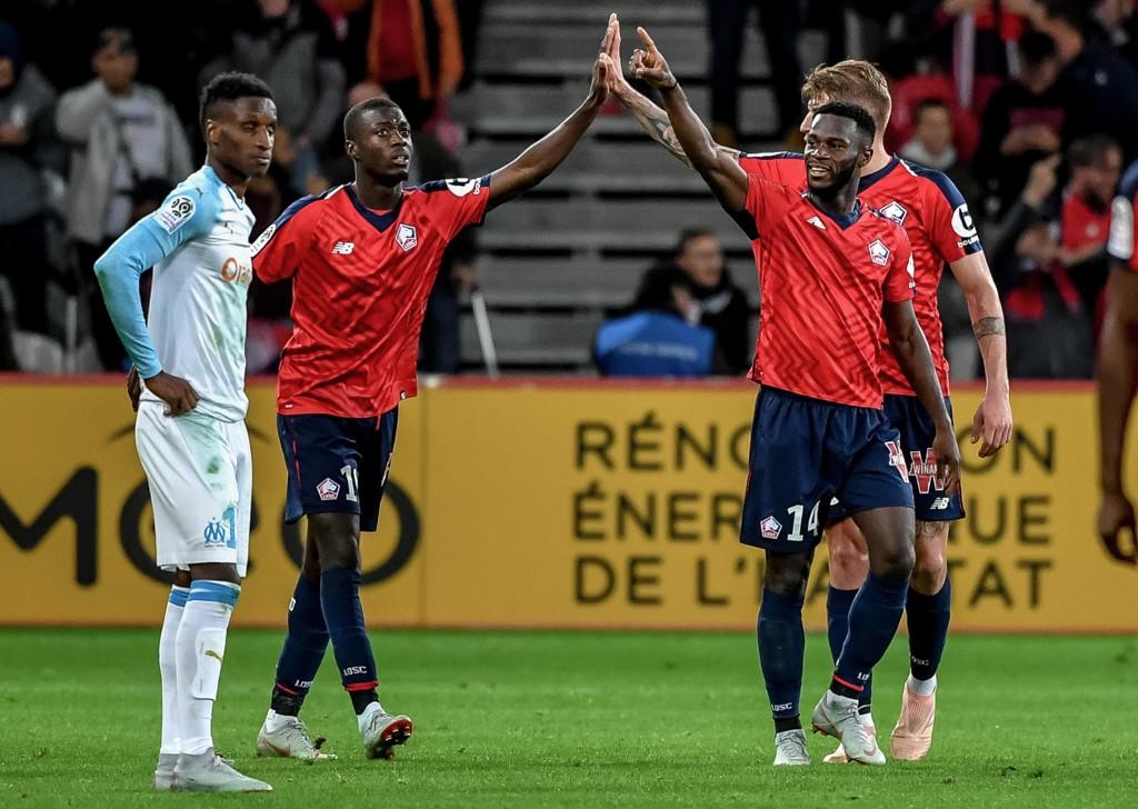 Lille og Jonathan Bamba jakter annenplassen i Ligue 1. fredag kveld. (Photo by PHILIPPE HUGUEN / AFP)