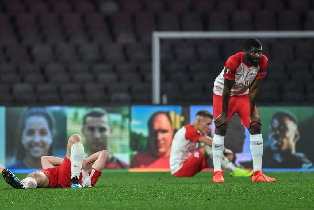 Salzburg's Jerome Junior Onguene fortviler etter at hans lag tapte 0-3 på Stadio San Paolo i Napoli forrige torsdag.